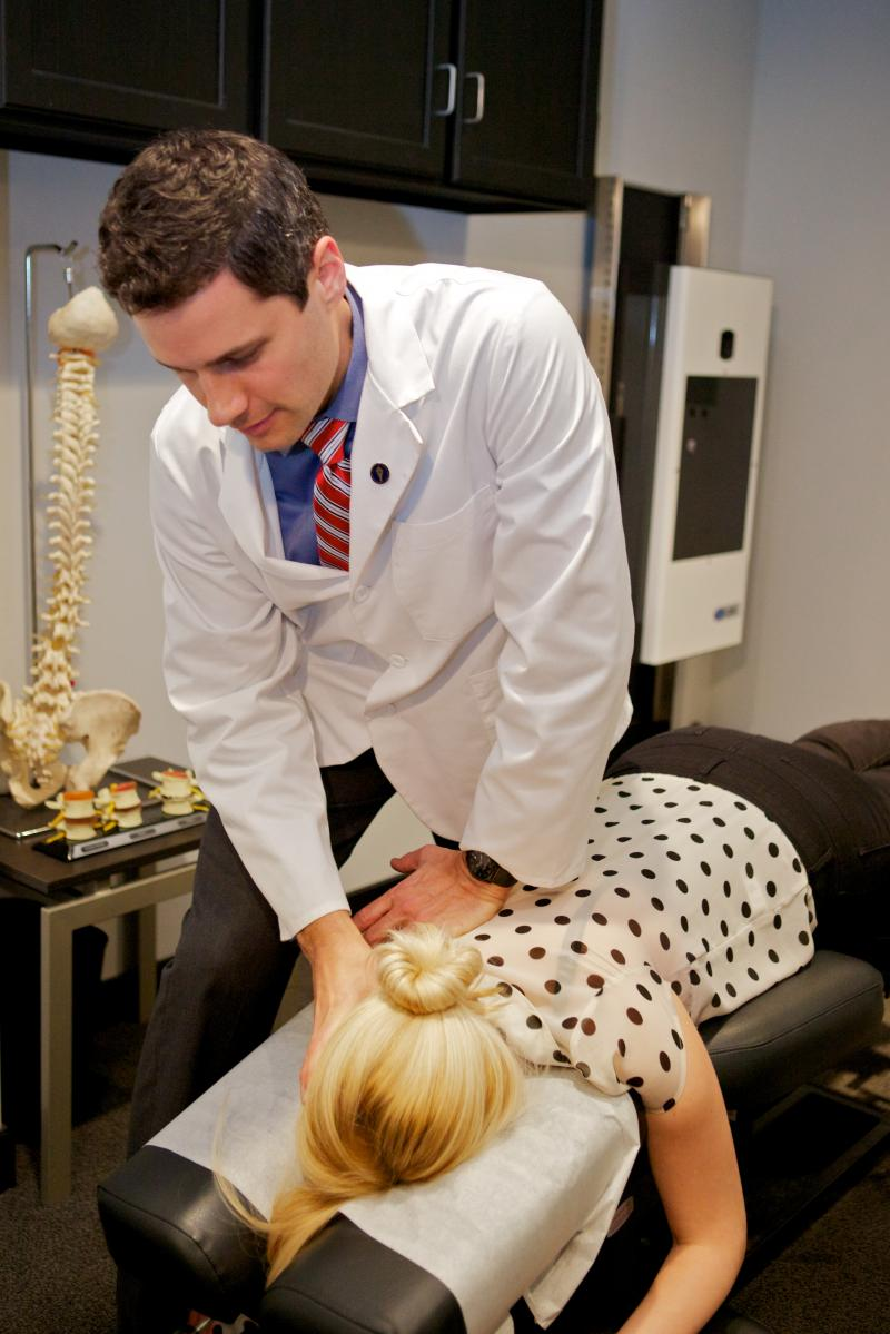 Dr. Josh Pennar, DC doing a chiropractic adjustment on a patient